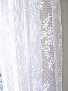 I wish I knew where to buy these lace curtains.  Oh and curtains are so expensive!