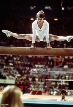 Nadia Comaneci, the 14 year old gymnastic sensation from Romania, demonstrates her balance during her routine on the balance beam at the 1976…