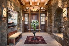 love the stone and arched cove. Interior ideas for lower level.