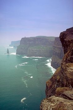The Cliffs of Moher near Doolin in County Clare, Ireland, rise 120 metres (394 ft) above the Atlantic Ocean at Hag's Head, their lowest point, and 214 metres (702 ft) north of O'Brien's Tower, their highest point. The scenic beauty makes the cliffs a popular tourist destination in Ireland that draws about one million visitors each year.