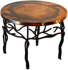 The iron work of this Copper Collection coffee table is hand-forged to produce a rough and bumpy bark-like texture, adding to the appeal of the twig design. The colorful hammered copper top will complement any d�cor in your living room!  Available in round, rectangular and square versions below, as well as with matching console and end tables.