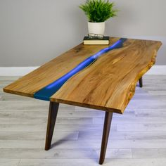 Handmade coffee table with 1 thick natural live edge English Elm slab on Walnut Legs  Craftsman made English Elm coffee table, of a