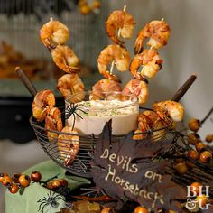 With this Halloween appetizer, your guests will be too busy saying yum to be frightened—that is once they get past the spider guarding the dip. The bacon-wrapped shrimp and accompanying dipping sauce make fiery hot and tasty Halloween hors d'oeuvres.
