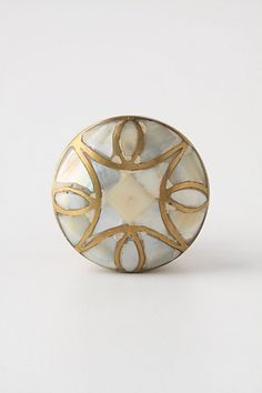 "Mother-Of-Pearl Knob - Anthropologie.com Brass and mother of pearl with brass. 1""wide. $14"