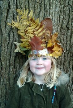 Make a leaf crown - either by leaf stitching with leaf stems or by making a head band and using double sided sticky tape on which to attach the leaves.