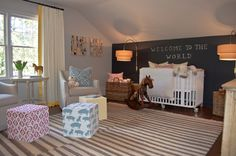 nursery : crib on casters, band on curtains, chalkboard wall + sconces