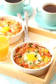 This easy baked eggs recipe cooked inside a bowl of cheesy hash browns topped with bacon and fresh herbs will be your new favorite breakfast or brunch for lazy weekend mornings!!