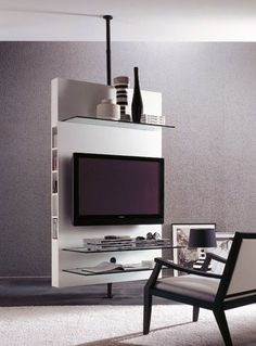 Don't know what to do with your TV? Here is one idea from Porada Italy - Revolving TV stand