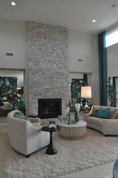 photo salon moderne gris cheminée en pierre