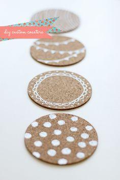 DIY Cute Custom Coasters - Take ordinary, boring cork coasters and turn them into a pretty table accessory.