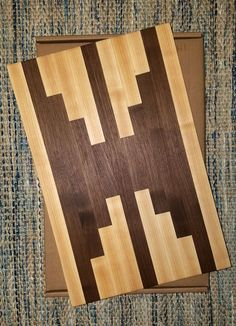 Beautifully handcrafted edge grain Walnut Maple cutting board. Size 12 in x 18 x 1 in  Perfect fit for your kitchen and cooking experience.  Great wedding and housewarming gift.  Finished with mineral oils.