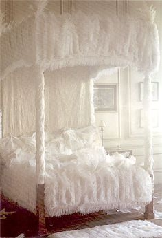 fluffy white bed via This is Glamorous