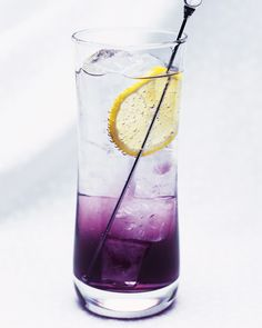 How to Make a Purple Viking Cocktail: The Purple Viking features Southern Comfort and blueberry liqueur in a tall, refreshing highball.