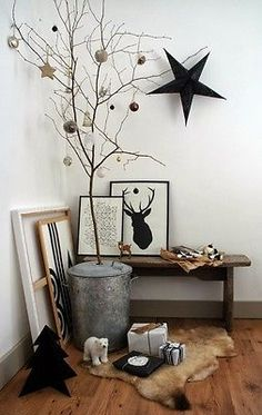Bare Tree with Ornaments Hege in France blog makes a statement with this simple tree with ornaments. I love this idea because just a few scattered ornaments give a pretty corner a festive look.  www(dot)hegeinfrance(dot)com/christmas-or-too-early/