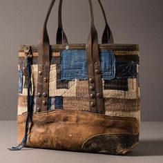 Navajo tote with indigo patches, vintage leather base, studded straps