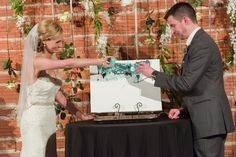 Bride and Groom painting on canvas during wedding ceremony