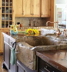 This imaginative New Vernon homeowner (and busy mother of five) wanted rustic and rugged in her new kitchen. Her wish list included a stone sink.