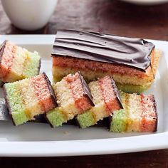 Rainbow Layered Cookies Recipe -Balanced beautifully in the sweet spot between cake and cookie, these sensational slices will be the centerpiece of your cookie tray.—Sherry Thompson, Seneca, South Carolina