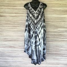 NWOT. Embroidered Tye Dye Dress Absolutely gorgeous dress. It's free size, will fit a M-XL. Black, white and grey. Embroidered with sequins. No Trades. Never been worn. Island Expressions Dresses Asymmetrical