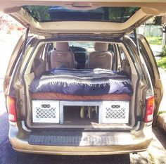 HOW TO CONVERT A MINIVAN TO A CAMPER We converted our 2001 Ford Windstar minivan to a comfortable camper with plenty of storage for traveling. We used milk crates with home made plywood lids to create. Minivan Camper Conversion, Car Camper, Rv Campers, Camper Van, Camper Life, Convert Van To Camper, Minivan Camping, Truck Camping, Stealth Camping