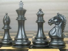 Weighted Staunton Ebony Wood Chess Set Pieces 4Q. http://www.chessbazaar.com/chess-pieces/wooden-chess-pieces/weighted-staunton-ebony-wood-chess-set-pieces-4q.html