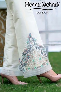 Ivory raw silk trousers with thread and sequinned embroidery. Available in trousers or boot cut trousers. Please note these are trousers only. Please note del Salwar Designs, Kurti Designs Party Wear, Embroidery Suits Design, Embroidery Fashion, Fashion Pants, Look Fashion, Salwar Pants, Stylish Clothes For Women, Dress Neck Designs