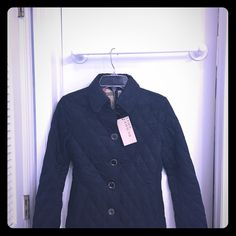 """Navy Blue Quilted Jacket I bought this beauty off of eBay and when I went to file a claim they said it was past the 30 day mark and the buyer sort of """"disappeared"""". Oh well :( it says size medium but fits more like a xs/s. Brand new never worn condition. Not authentic! Jackets & Coats"""