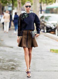 Candela Novembre showcases an emerald, sequin-embellished sweatshirt. // #StreetStyle