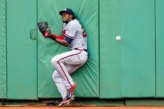 Nice try  -         Cameron Maybin of the Atlanta Braves hits the wall after attempting to catch a triple hit by Mookie Betts of the Boston Red Sox during the sixth inning of a game on June 16 at Fenway Park in Boston.  -    © Michael Ivins/Boston Red Sox/Getty Images