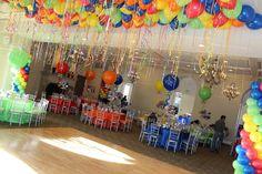 Amusement Park Themed Bar Mitzvah Amusement Park Themed Bar Mitzvah with Bright Colored Balloons at Temple Shaaray Tefila, Bedford, NY