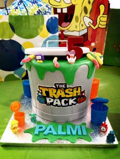 The Trash Pack garbage can birthday cake with edible ooze and sour gummy worms