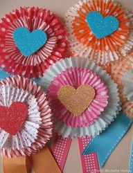 Cupcake liners...put a safety pin on the back or a bobby pin (so they dont hurt themselves) and the nursing home patients could wear them!