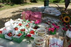 From my actual picnic party - I got little baskets at the Dollar Tree and lined them with red and white gingham fabric.  The kids could then fill them with a green basket of strawberries, pre-packed (but made from scratch) caprese pasta salad, pre-packed (also from scratch) potato salad, and sandwiches wrapped in parchment.  The kids also got bamboo utensils which I wrapped in a white napkin and secured with a gingham ribbon.  The table itself is covered in burlap.
