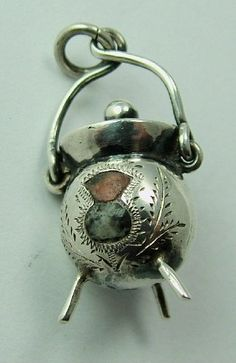 An Edwardian silver cauldron charm with moving handle that is set with thistle shaped agates, c1909 - 58 gbp