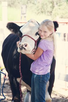 little girl and her cow..adorable