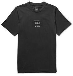 OAMC's aesthetic is an expert blend of minimalist and progressive elements. This black cotton-jersey T-shirt is the perfect example - cut in a regular fit, it's printed with simple white text at the front, excerpted from Sun Tzu's The Art of War. The back features a re-imagined olive branch-bearing dove, with fists up ready to fight.