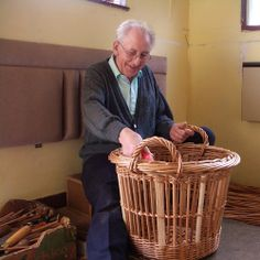 "Terry Bensley finishing a traditional Yarmouth 1/4 herring cran basket in his workshop in Great Yarmouth, England in April, 2006. Terry has self produced two basketmaking DVDs - ""The Great Yarmouth Herring Swill"" and ""The Norfolk Flower Gatherer""."