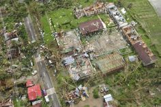 AN AERIAL VIEW SHOWS DAMAGED HOUSES AFTER TYPHOON HAIYAN HIT LLOLIO PROVINCE IN CENTRAL  PHILIPPINES
