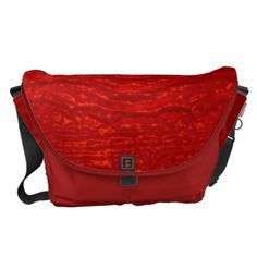"Red lava flow by Valxart.com messenger bag by Valxart.com $141.70 Water resistant, extra durable (machine-washable). Large main compartment and 2 front pockets. Form fitted to your body. Quick-adjust cam shoulder strap. Holds a 15"" laptop (w/optional sleeve). Made with a sustainability focus in San Francisco, CA. Dimensions 12"" H x 21"" W x 9"" D."