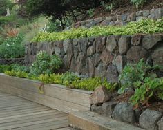 modern landscape traditional style stone walls wooden paths