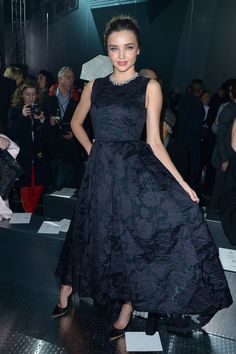 Miranda Kerr took a ladylike approach to dressing for the H&M Fall 2014 show in a floral dress.
