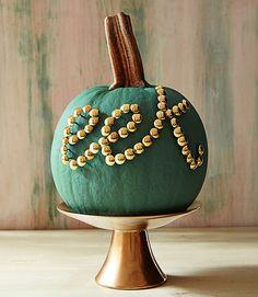 Create an awesome pumpkin design with thumbtacks.