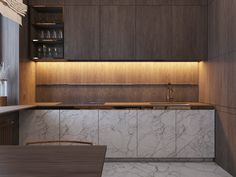 Cabinetry doesn't necessarily have to be cohesive. This modern kitchen with under cabinet lighting is a great example of contrast.