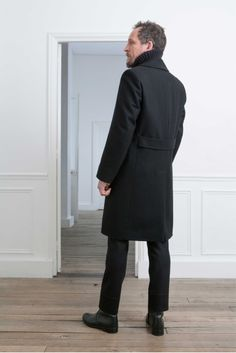 24. Double-breasted coat in wool and cashmere melton / Turtleneck in knitted yak wool and virgin wool / Boots in vegetal calf leather