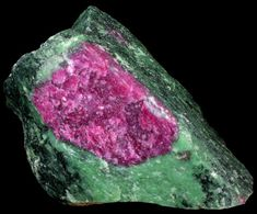 """Green Zoisite with Included Ruby from Longido, Arusha, Tanzania Ruby crystal embedded in green chrome-rich Zoisite (""""Ruby Zoisite"""") from the famous mining area west of Mount Killimanjaro."""
