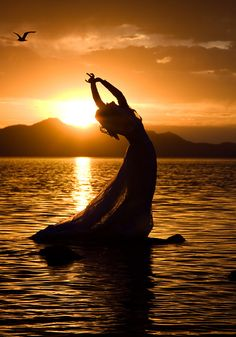 breathtaking photo of  woman, orange sun, bird &sea  ~I give you this one thought to keep ~ I am with you still, I do not sleep. I am a thousand winds that blow, I am the diamond glints on snow, I am the sunlight on ripened grain, I am the gentle autumn rain. When you awaken in the morning hush, I am the swift uplifting rush of birds in circled flight. I am the soft stars that shine at night. Do not think of me as gone.. I am with you still... in each new dawn.