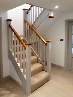 A half landing American White Oak staircase. The newel caps and handrail have been left unpainted to complement the overall look. Oak Handrail, Staircase Landing, Staircase Storage, Staircase Handrail, White Staircase, Painted Staircases, House Staircase, Oak Stairs, Staircase Makeover