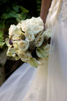 Gorgeous white roses, lilly's, twigs with fall accents