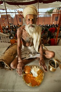 """""""Sitarani Tyaagi, an ascetic Hindu priest, with his typical day's worth of food at an ashram in Ujjain, India. The caloric value of his typi..."""