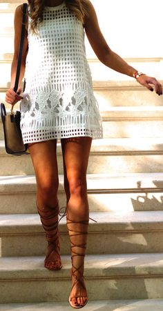 Brooke Carrie Hil is wearing a white dress and beige lace up sandals from Zara.